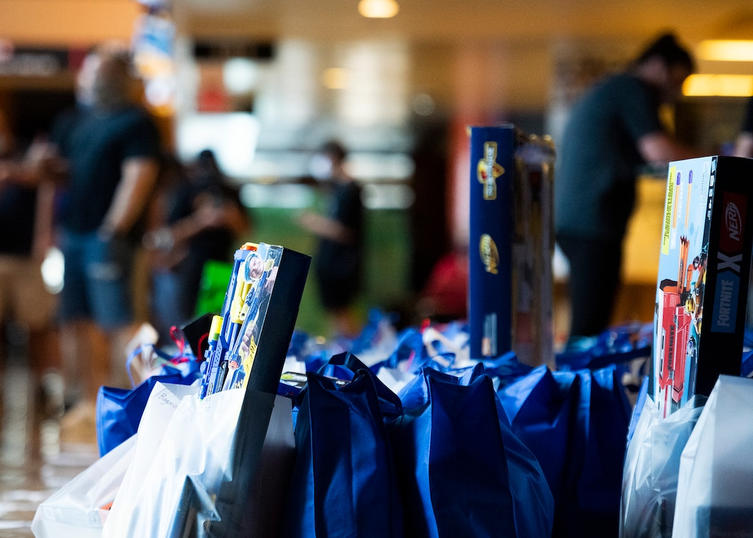 Bags are packed prior to the Back to School Bash drive-thru July 23, 2020, at the Gila Bend Arena in Glendale, Ariz.