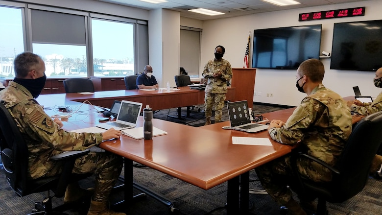 U.S. Air Force Staff Sgt. Angelynn Bailey, 61 CS Knowledge Manager, serving as the SMC Commanders Action Group NCOIC, briefs Brig. Gen. Donald Cothern about the meeting agenda for the virtual leadership discussion on race and diversity at Los Angeles Air Force Base, Calif., July 10, 2020.  The EDDP program is a 61st Air Base Group initiative that grants the opportunity for enlisted Airmen to gain experience outside of their normal career field and duties, while supporting the overall Space and Missile Systems Center (SMC) mission.  (U.S. Air Force photo by Staff Sgt. Randy Duffy)