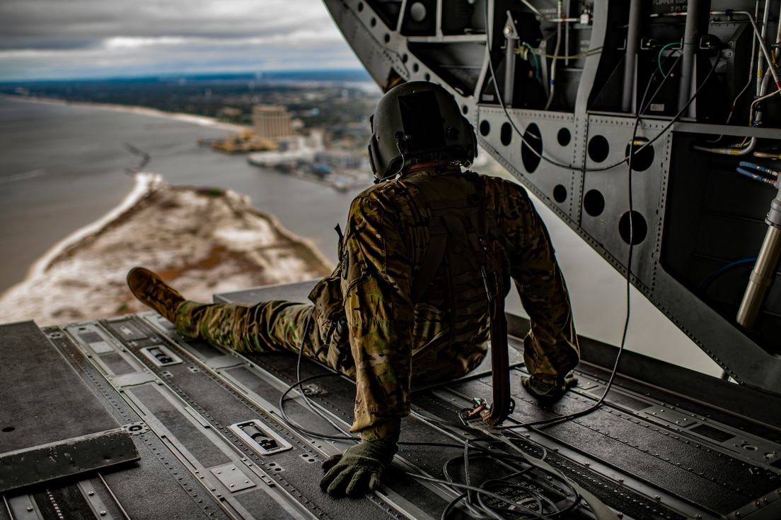 U.S. Air and Army National Guard members take flight during an incentive ride on board a CH-47 Chinook assigned to the 2-238th General Support Aviation Battalion, Detachment 1, Bravo Company, South Carolina Army National Guard, nearing the end of PATRIOT South 2020 at the Gulfport Combat Readiness Training Center in Gulfport, Miss., Mar. 5, 2020.