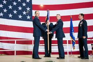 two people holding a flag