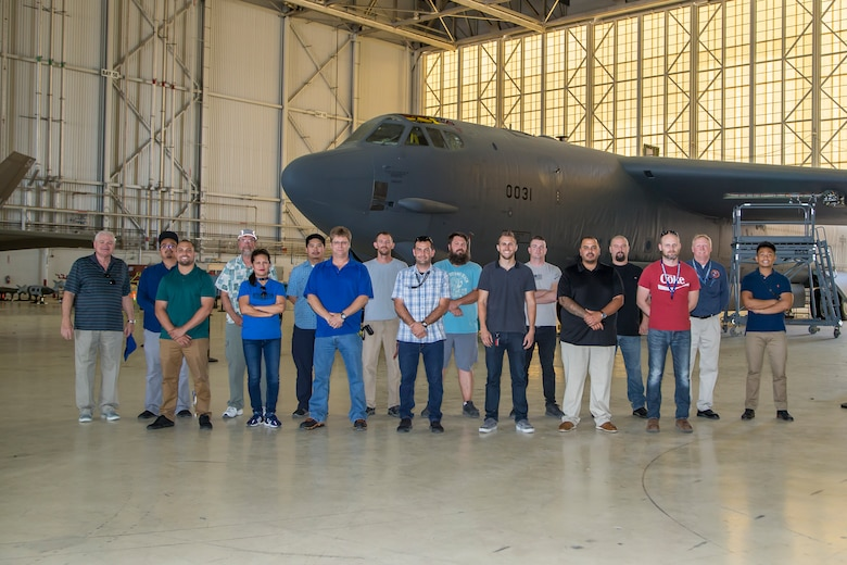 Members of the Bomber Instrumentation Team, 812th Aircraft Instrumentation Test Squadron, pose for a group photo in front of a B-52 Stratofortress at Edwards Air Force Base, California, Aug. 5, 2019. (Air Force photo by Ethan Wagner)