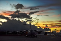 A 60th Air Mobility Wing C-17 from Travis Air Force Base, California, prepares to take off from the Hickam Field flight line July 17, 2020, at Joint Base Pearl Harbor-Hickam, Hawaii. A team of Airmen from several commands rapidly executed a Transport Isolation System in support of a COVID-19 bio-containment aeromedical evacuation mission. This is the first time the TIS was utilized in the Indo-Pacific area of operations. The TIS is an infectious disease containment unit designed to minimize contamination risk to aircrew and medical attendants, while allowing in-flight medical care for patients afflicted by a disease. (U.S. Air Force photo by Tech. Sgt. Anthony Nelson Jr.)