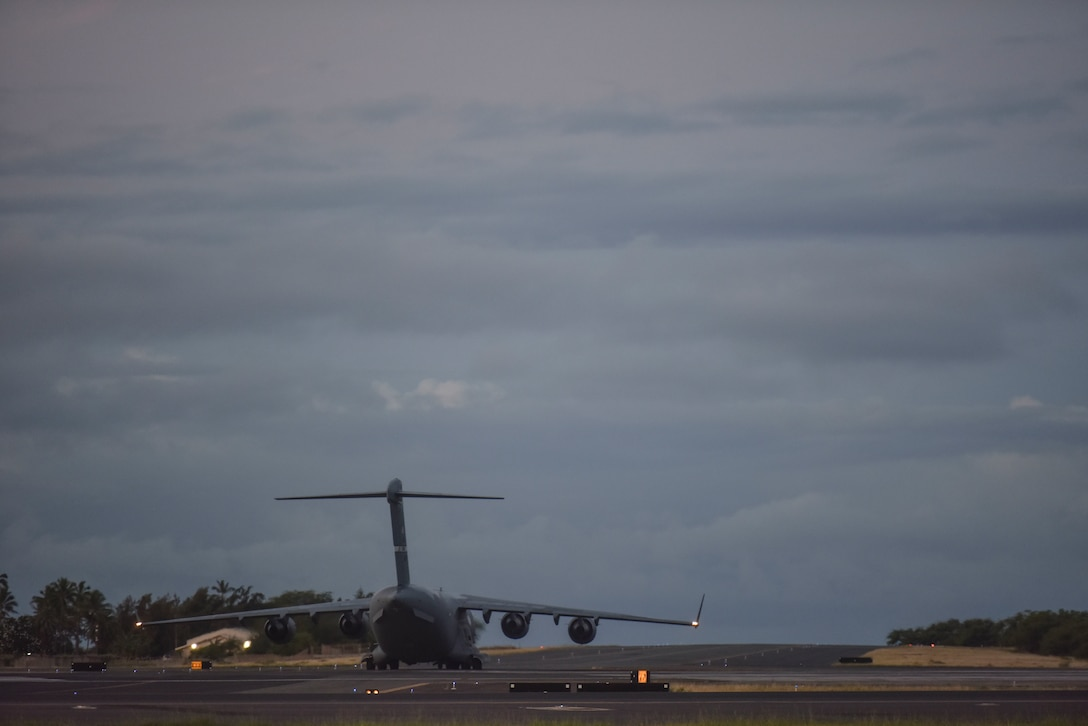 A 60th Air Mobility Wing C-17 from Travis Air Force Base, California, taxis from the Hickam Field flight line July 17, 2020, at Joint Base Pearl Harbor-Hickam, Hawaii. A team of Airmen from several commands rapidly executed a Transport Isolation System in support of a COVID-19 bio-containment aeromedical evacuation mission. This is the first time the TIS was utilized in the Indo-Pacific area of operations. The TIS is an infectious disease containment unit designed to minimize contamination risk to aircrew and medical attendants, while allowing in-flight medical care for patients afflicted by a disease. (U.S. Air Force photo by Tech. Sgt. Anthony Nelson Jr.)
