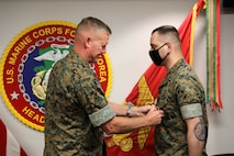 Commander of U.S. Marine Corps Forces Korea, MajGen. Bradley S. James awards MSgt. Daniel Ahmed the Meritorious Service Medal for his outstanding performance while serving as the G-1 Chief for MARFORK, July 29, 2020. (U.S. Marine Corps Photo by Sgt. Parker R. Golz)