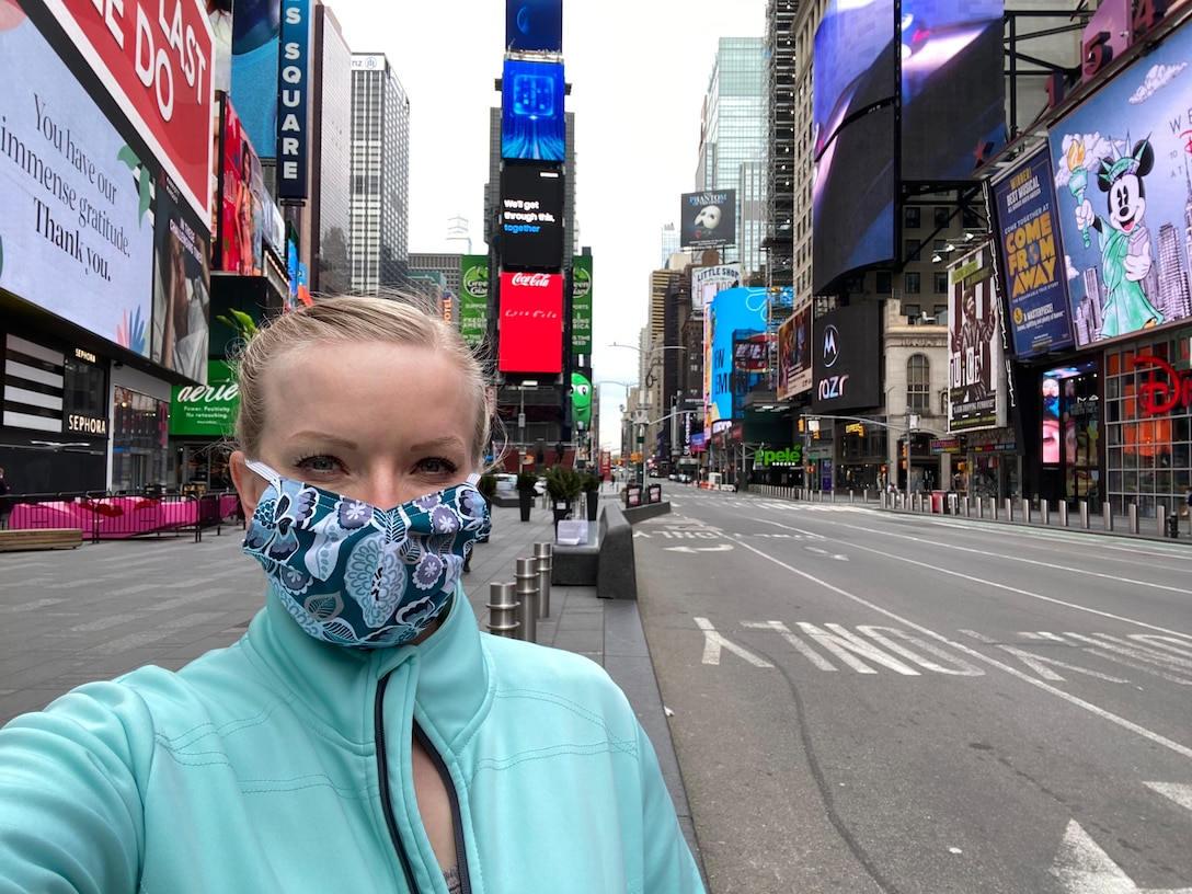 Capt. Melinda McClendon takes a selfie with Times Square behind her. There are no people or traffic on Times Square.