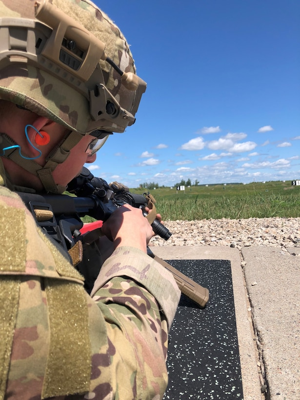 An Air National Guard Explosive Ordnance Disposal technician trains using advanced marksmanship techniques during a field training exercise at Camp Ripley Training Center, Minnesota, July 20-24, 2020.