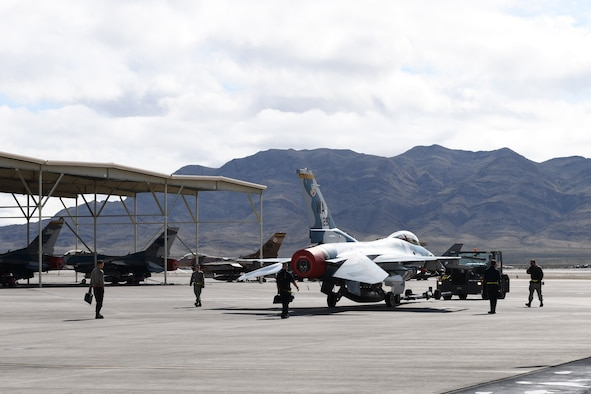 Maintenance Airmen working on the Nellis Air Force Base, Nevada, flight line.