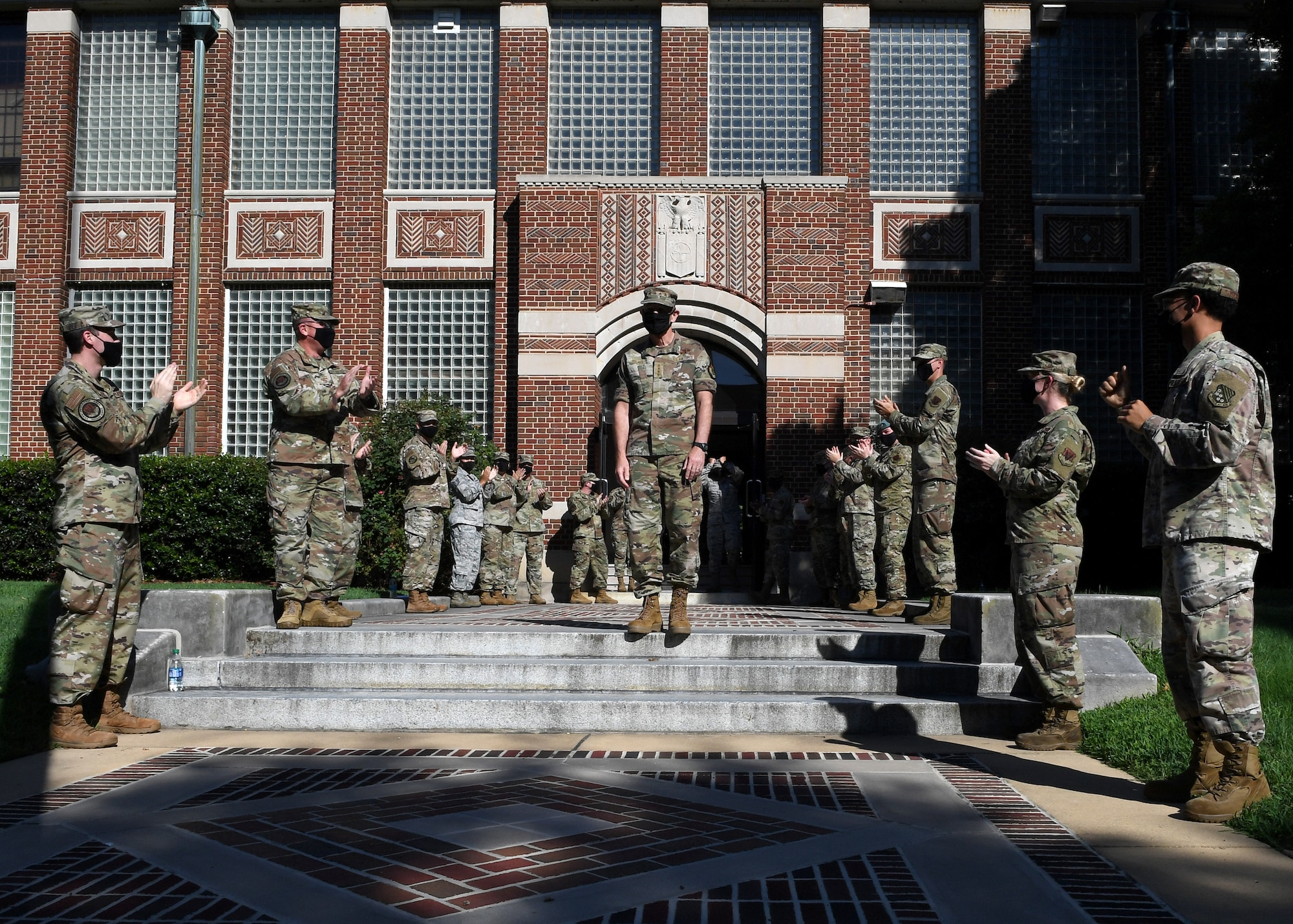 General Holmes is greeted by Airmen at the door