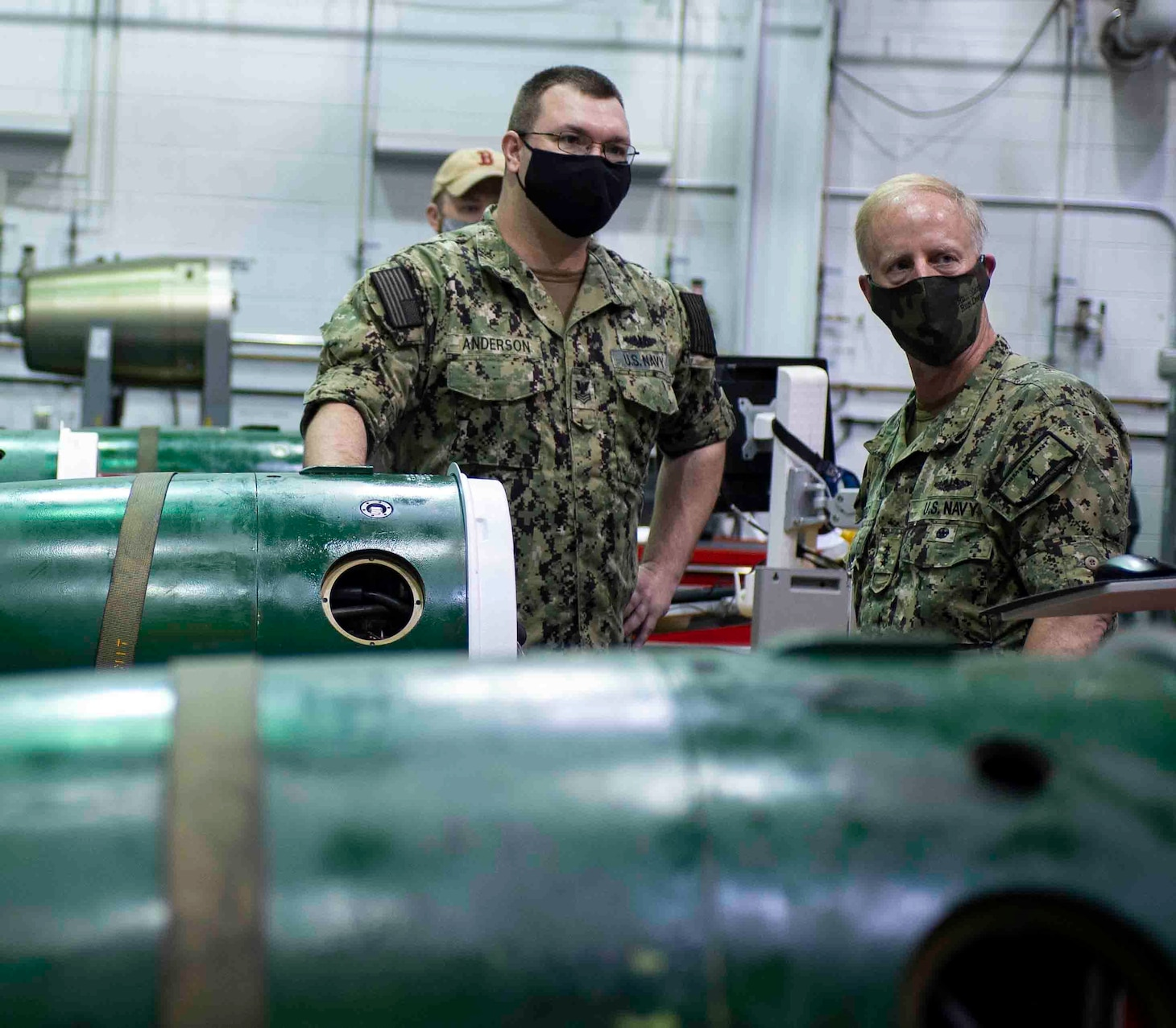 Torpedoman 1st Class Gary Anderson explains the components of a Mark 48 torpedo.