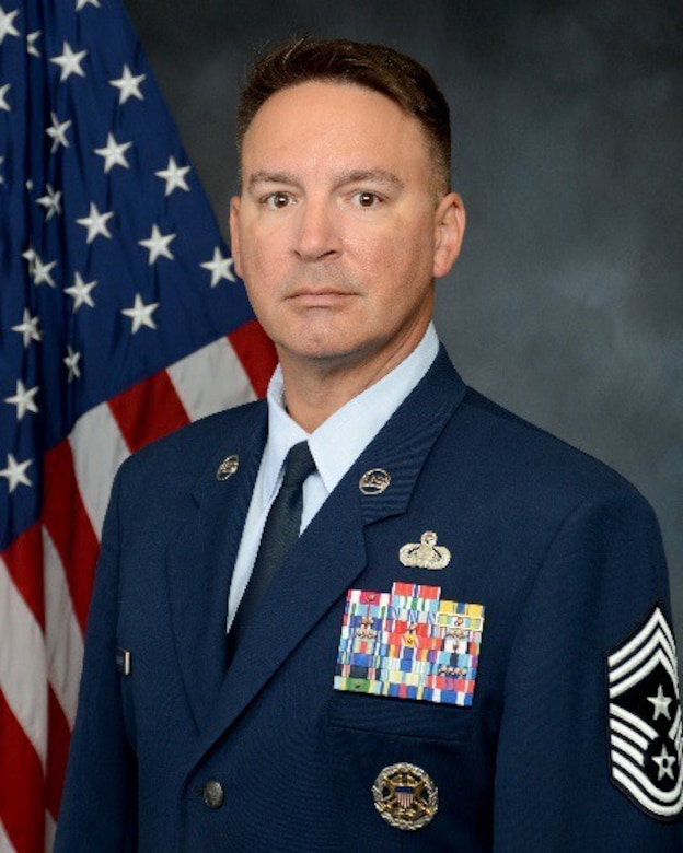 Chief Master Sgt. Brian Bischoff, 960th Cyberspace Wing command chief, stands for an official photo. (U.S. Air Force courtesy photo)