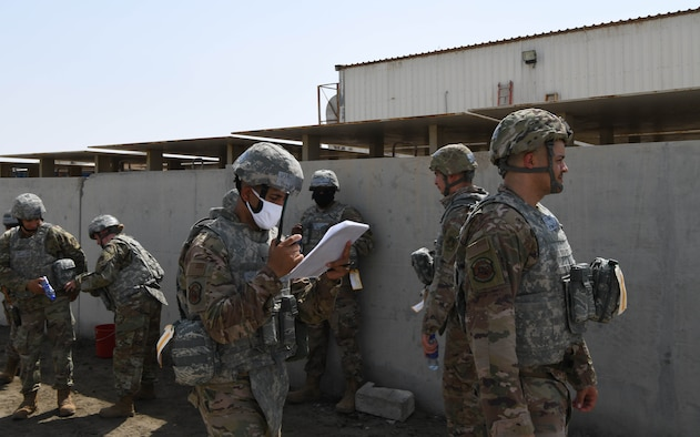 Airmen from the 380th Expeditionary Civil Engineer Squadron go through accountability checklists after a bunker dive during a rotational exercise July 21, 2020, at Al Dhafra Air Base, United Arab Emirates. The exercise gives deployers an opportunity to execute some of the techniques taught to them during training at home station. (U.S. Air Force photo by Tech. Sgt. Charles Taylor)