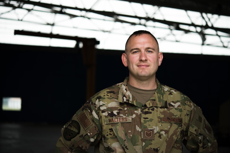 Photo of Airman in uniform posing for a photo