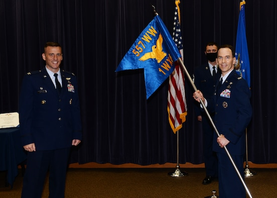 Col. Bradley Stebbins receives the guidon and assumed command of the 1st Weather Group in a socially-distanced ceremony on June 24, 2020 in the Chief Master Sgt. Peter Moore auditorium on Offutt Air Force Base, Nebraska.