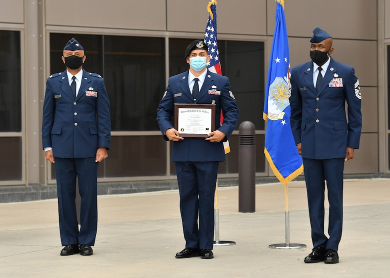 SCHRIEVER AIR FORCE BASE, Colo. -- Nine members of the Schriever AFB Community were awarded their Community College of the Air Force (CCAF) degrees during a ceremony held at Schriever AFB, Colorado, 27 July 2020. The CCAF degree is the equivalent of an associates degree and is earned by Air Force members in a variety of qualified specialties related to their career fields.  (U.S. Air Force Photo/Dennis Rogers)