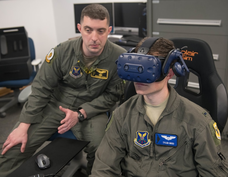 509th Bomb Wing Innovation Director, U.S. Air Force Capt. Benjamin Kram (Left), instructs 13th Bomb Squadron T-38A Trainer Instructor Pilot, U.S. Air Force 1st Lt. Tyler Reed, on how to operate the T-38 Virtual Reality simulator at Whiteman Air Force Base, Missouri, June 24, 2020. VR technology allows pilots to train on specific aircraft to gain exposure and experience. (U.S. Air Force photo by Senior Airman Thomas Johns)