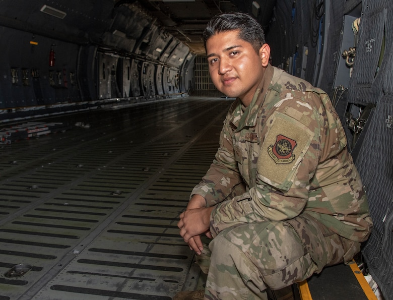 U.S. Air Force Senior Airman Christopher Gonzales, 60th Aircraft Maintenance Squadron crew chief journeyman, sits in a C-5M Super Galaxy cargo bay July 28, 2020, at Travis Air Force Base, California. Gonzales was the Warrior of the Week from July 26-Aug 1, 2020. The program recognizes outstanding Airmen who have made significant contributions to their unit. (U.S. Air Force photo by Heide Couch)
