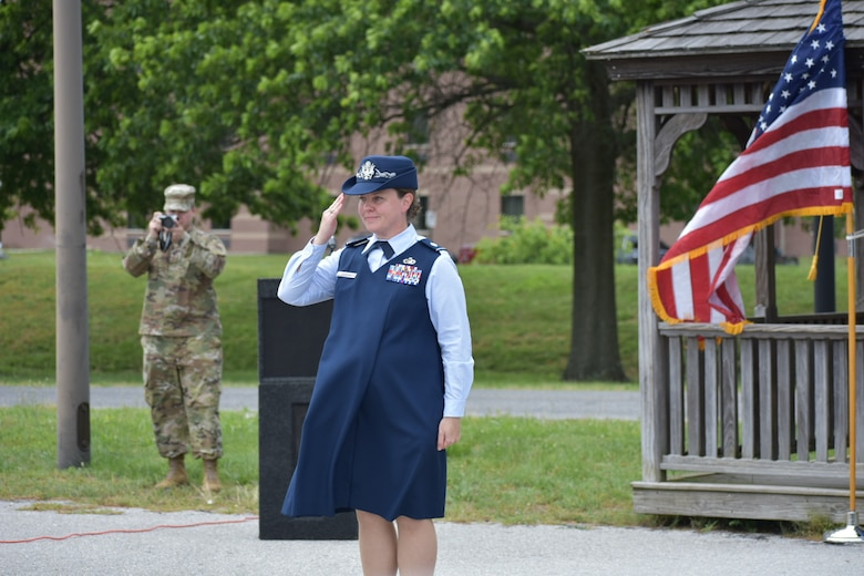 Lt. Col. Hallie Herrera salutes during her change of command ceremony at Fort George G. Meade, Md., June 16, 2020. Hererra, who was eight months pregnant at the time, took command of the 22nd Intelligence Squadron. (U.S. Air Force courtesy photo by Felix Herrera)
