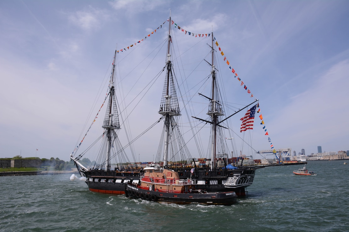 photo of uss constitution sailing away in ocean