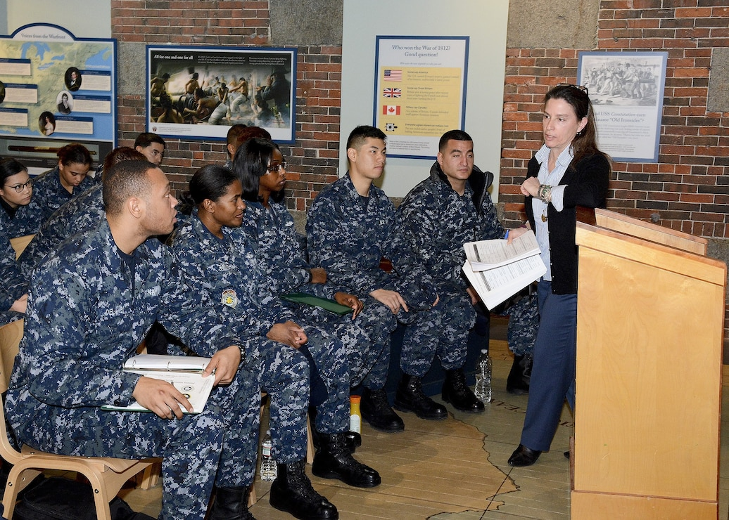 historian at Naval History & Heritage Command (NHHC) Detachment Boston, instructs the crew members of USS Constitution as part of the crew's continuing education of Old Ironsides' history
