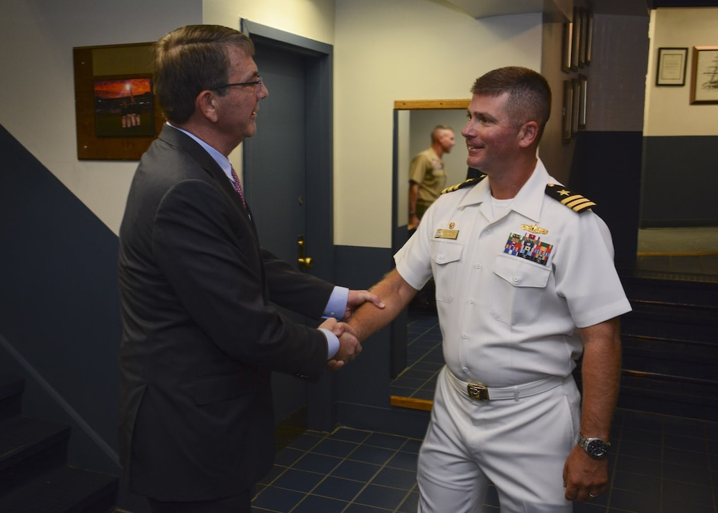 Honorable Ashton Carter, Secretary of Defense, meets Cmdr. Robert S. Gerosa Jr., 74th Commanding Officer of USS Constitution