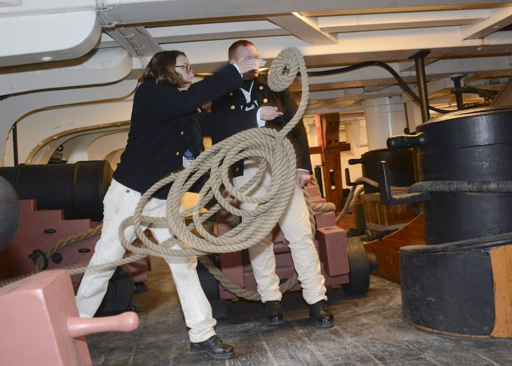 Sailors demonstrates gun drills onboard the ship