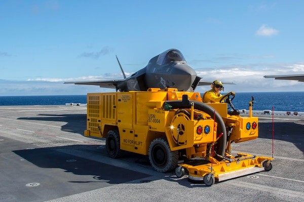 A Sailor operates the Mobile Cleaning, Recovery, and Recycling System (MCRRS) on the flight deck of USS America (LHA 6) on Nov. 1, 2016.