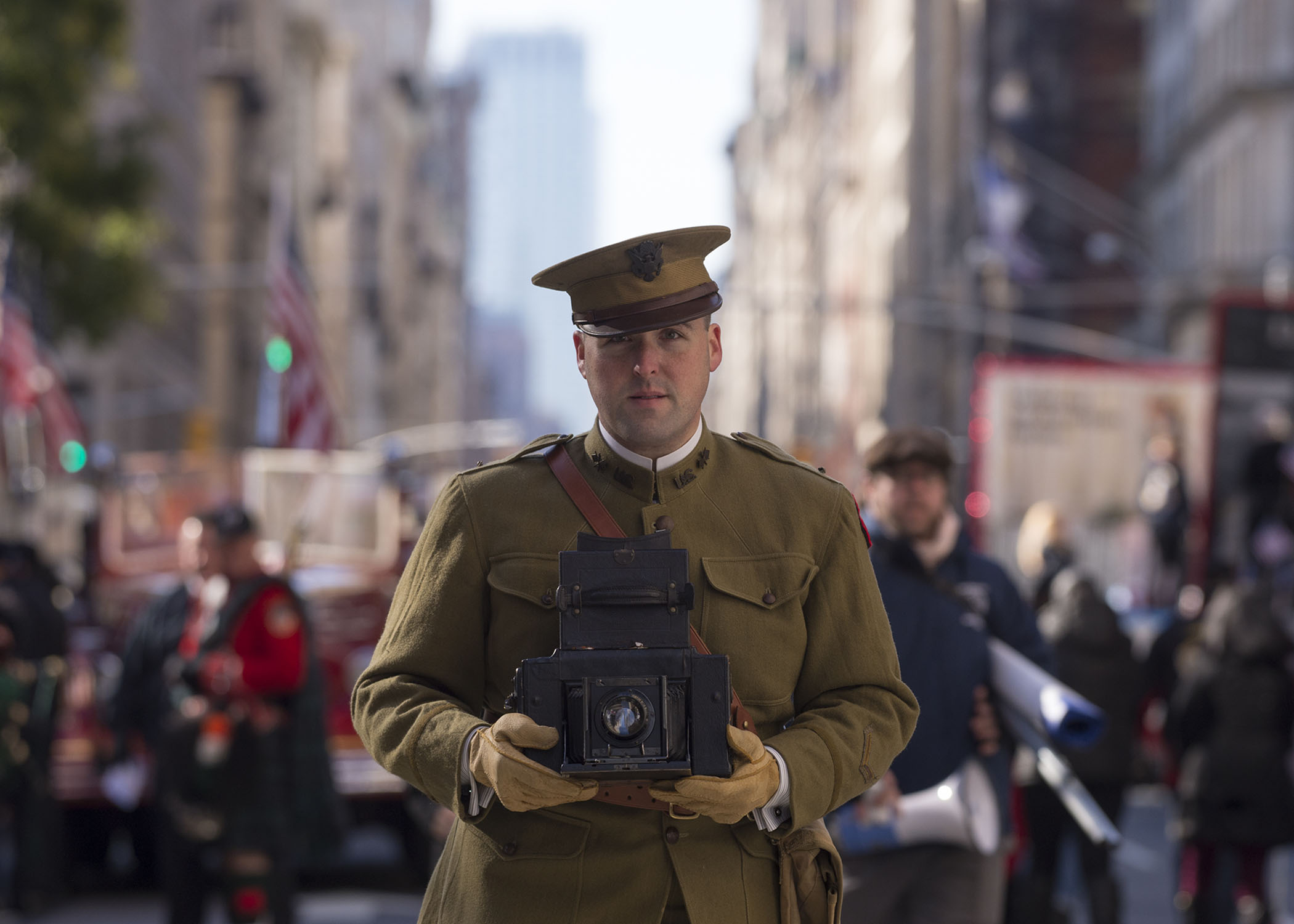 Person in hisortic uniform holding a vintage camera