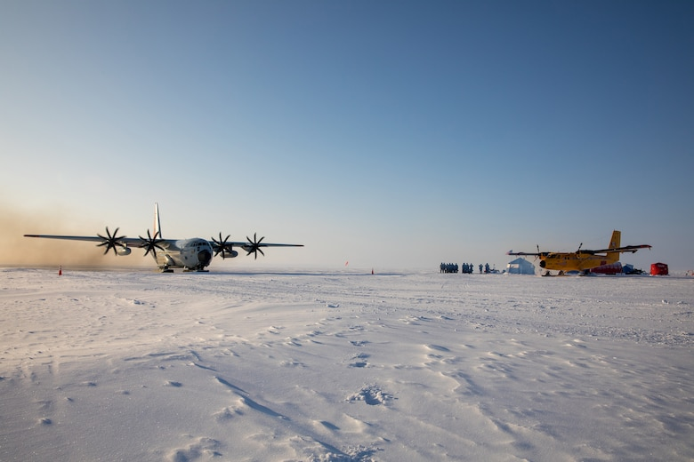 An LC-130 Hercules from the 109th Airlift Wing and a Twin Otter from the Canadian Royal Air Force's 440th Squadron at the remote skiway construction camp during Air National Guard exercise Arctic Eagle, March 1st, 2020.