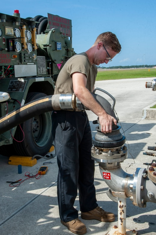 U.S. Air Force Senior Airman Sean Kissel, a 6th Logistics Readiness Squadron firetruck and refueling mechanic connects a nozzle from an R-12 refueling truck to a jet fuel hydrant system, July 15, 2020, at MacDill Air Force Base, Fla.