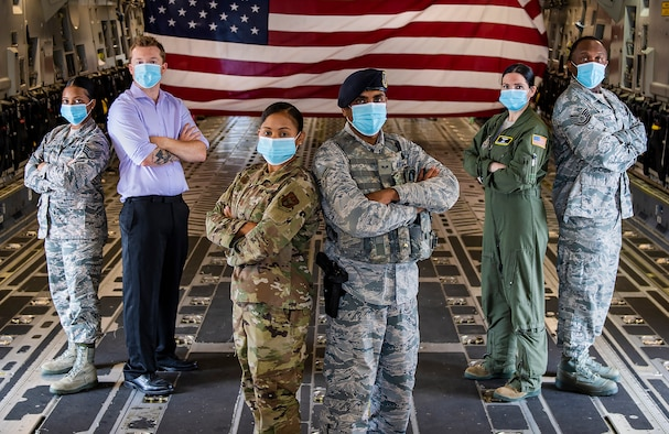 Airmen assigned to the 911th Airlift Wing pose for a portrait photo at the Pittsburgh International Airport Air Reserve Station, Pennsylvania, June 23, 2020. The 911th AW, like every organization within U.S. Air Force Reserve Command, is made up of many individuals with diverse backgrounds. (Joshua J. Seybert)
