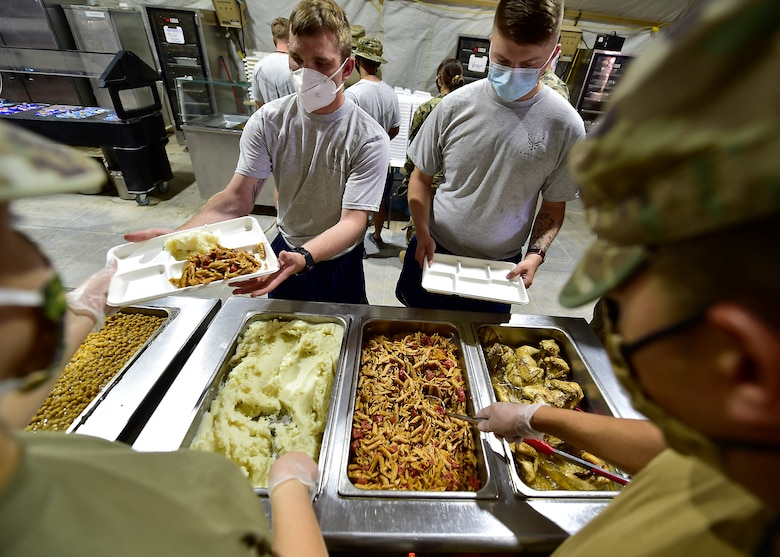 Airmen from the 378th Expeditionary Force Support Squadron services section prepare and serve lunch to base personnel.