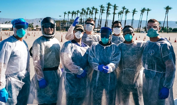 U.S. Air Force Capt. McGar (second from the left) stands with his fellow 144th Fighter Wing medical strike team members at a COVID-19 drive-thru testing site in Indio, Calif.