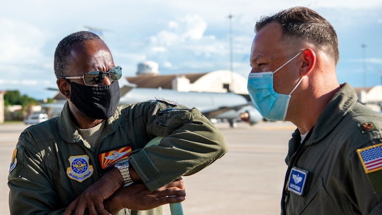 U.S. Air Force Col. Travis Edwards, the acting 6th Air Refueling Wing vice commander, and Maj. Aaron Parson, the 6th Operations Group chief of standardization and evaluation, prepare for a flight at MacDill Air Force Base, Fla., Jul. 20, 2020.