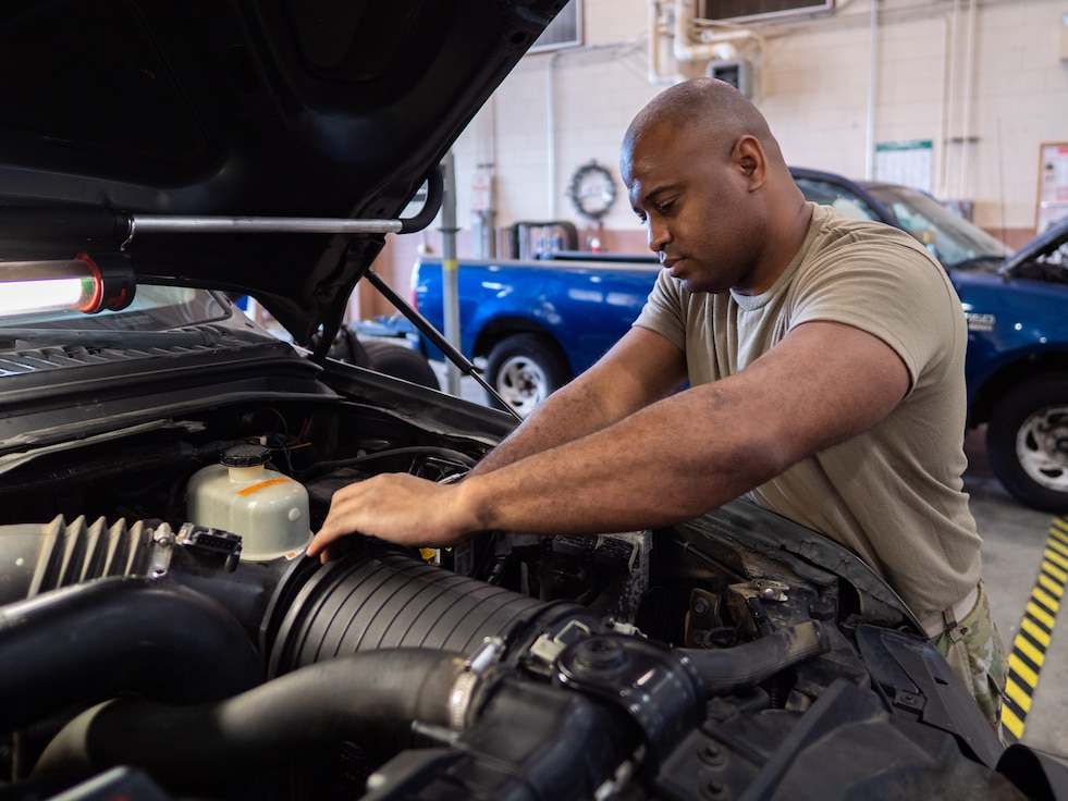 U.S. Air Force Tech. Sgt. LaQuan Howell, a vehicle maintenance specialist with the 116th Air Control Wing, Georgia Air National Guard, changes an engine oil cooler in a Bobtail truck at Robins Air Force Base, Georgia, May 27, 2020. Bobtail trucks are an integral part of the ground vehicle fleet used to haul equipment on the flight line. Vehicle maintenance specialists keep these and the rest of our fleet of vehicles operating to meet mission requirements. (U.S. Air National Guard photo by Senior Master Sgt. Roger Parsons)