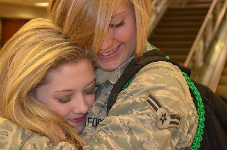 U.S. Air Force Airman 1st Class Kaylee Champion hugs her sister Kourtney. (Courtesy photo)