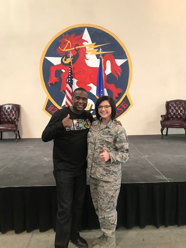 """U.S. Air Force Staff Sgt Kaylee Champion poses for a photo with her mentor, retired Chief Master Sgt. Juan Lewis, """"The Fired Up Chief."""" (Courtesy photo)."""