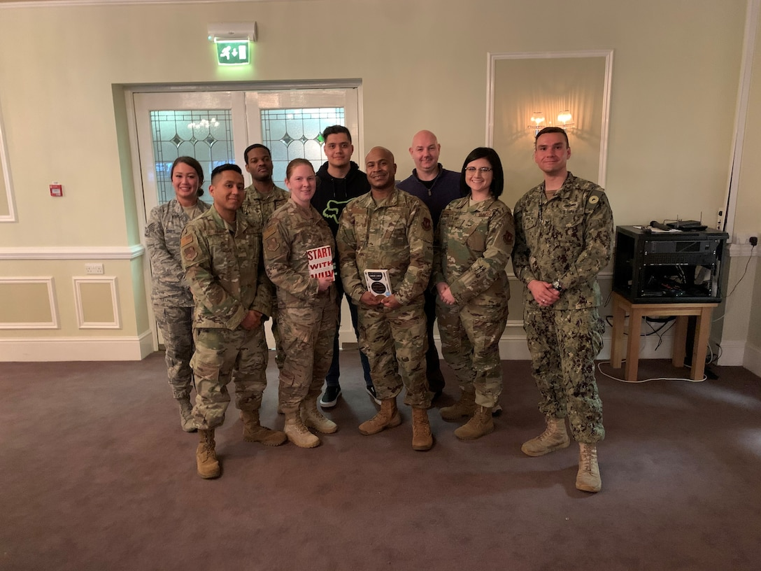 U.S. Air Force Staff Sgt Kaylee Champion, second from far right, 501st Combat Support Wing logistics planner, poses for a group photo with the 423rd Air Base Group Joint Service 5/6 Council at the NCO Social at RAF Alconbury, England, March 2020. The council learned professional development skills and furthered their NCO leadership skills. (Courtesy photo).