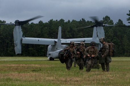 U.S. Marines with 2d Battalion, 2d Marine Regiment, 2d Marine Division execute an aerial infiltration as part of Exercise Deep Water on Camp Lejeune, North Carolina, July 29, 2020. Deep Water is a 2d Marine regiment-led exercise designed to provide Marine Air-Ground Task Force capabilities, which increases lethality and combat effectiveness for future combat operations. The exercise included the largest air-assault conducted in decades.