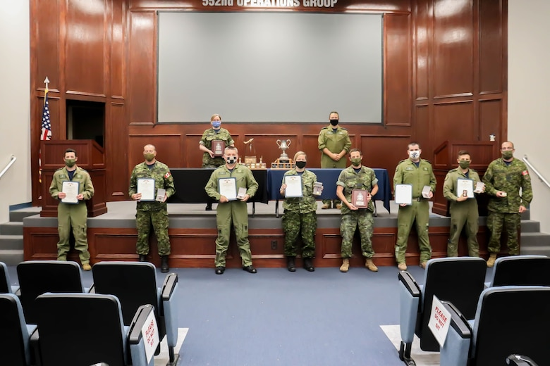 Members of the Canadian Detachment with the 552nd Air Control Wing at Tinker Air Force Base, Oklahoma, are recognized with Air Medals and Oak Leaf Clusters. The individuals distinguished themselves by providing critical command, control and communications support during 20 or more missions in Operation Enduring Freedom, Operation INHERENT RESOLVE and Operation FREEDOM SENTINEL (U.S. Air Force photo by 1st Lt. Ashlyn K. Paulson).