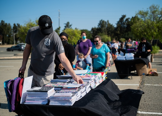 Military families receive back to school goods during an event.