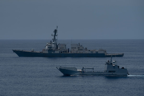 USS Halsey (DDG 97) participates in a passing exercise (PASSEX) with Guatemalan navy Quetzal Landing Craft, Utility (LCU) BL-1601.