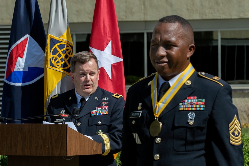 Brig. Gen. Mark S. Bennett, U.S. Army Financial Management Command commanding general, delivers remarks praising recently retired Sgt. Maj. Ronald Houston, U.S. Army Financial Management Command Operations senior enlisted advisor, during Houston's retirement ceremony at the Maj. Gen. Emmett J. Bean Federal Center in Indianapolis July 17, 2020. During his time at USAFMCOM, Houston oversaw all operational taskings, day-to-day functions and training of the command. (U.S. Army photo by Mark R. W. Orders-Woempner)