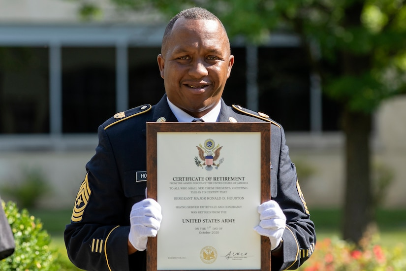 Recently retired Sgt. Maj. Ronald Houston, U.S. Army Financial Management Command Operations senior enlisted advisor, smiles as he holds his certificate of retirement from the U.S. Army at the Maj. Gen. Emmett J. Bean Federal Center in Indianapolis July 17, 2020. Houston was born and raised in New Orleans, Louisiana, and he joined the Army as a financial management specialist in May 1992, four days after graduating from high school. (U.S. Army photo by Mark R. W. Orders-Woempner)