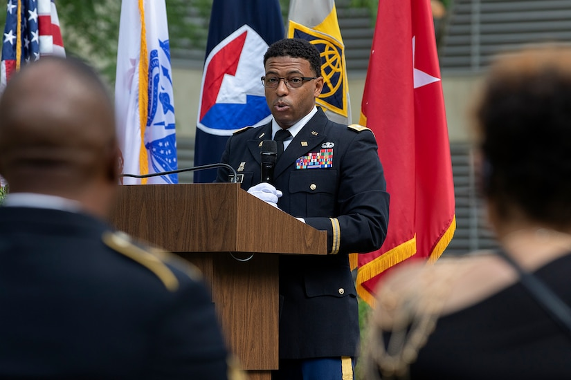 Lt. Col. Emanuel Dudley, U.S. Army Financial Management Command chief of Operations, delivers remarks as Sgt. Maj. Ronald Houston, USAFMCOM Operations senior enlisted advisor, and Shani Adams-Houston listen during the sergeant major's retirement ceremony at the Maj. Gen. Emmett J. Bean Federal Center in Indianapolis July 17, 2020. Sergeant Major Houston was born and raised in New Orleans, Louisiana, and he joined the Army as a financial management specialist in May 1992, four days after graduating from high school. (U.S. Army photo by Mark R. W. Orders-Woempner)