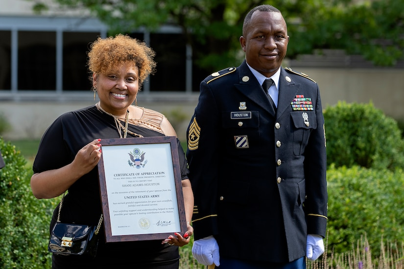 Shani Adams-Houston shows off her spouse certificate of appreciate as she stands next to her husband, Sgt. Maj. Ronald Houston, U.S. Army Financial Management Command Operations senior enlisted advisor, during the sergeant major's retirement ceremony at the Maj. Gen. Emmett J. Bean Federal Center in Indianapolis July 17, 2020. Sergeant Major Houston retired from the Army after more than 28 years of military service. (U.S. Army photo by Mark R. W. Orders-Woempner)