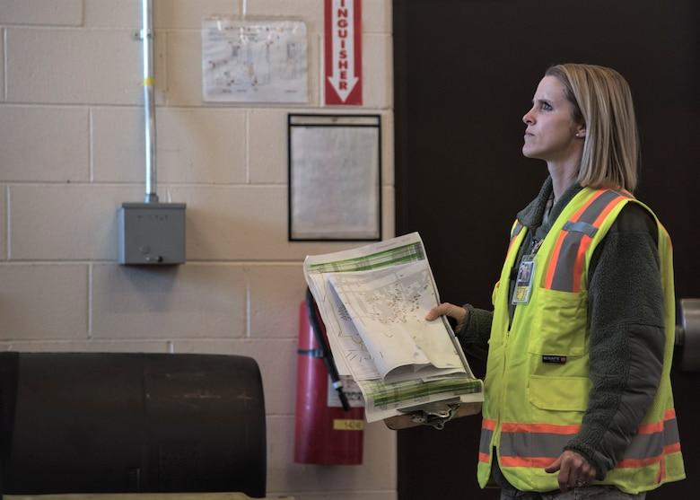 Staff Sgt. Courtney Kohnke performs a post-earthquake inspection on a facility at Joint Base Elmendorf-Richardson, Alaska in January 2019.