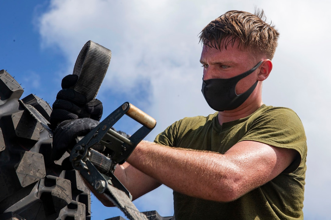 A Marine wears a face mask as he works.