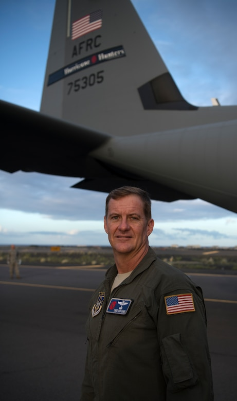 Chief Master Sgt. Rick Cumbo, loadmaster for the 53rd Weather Reconnaissance Squadron at Keesler Air Force Base, Mississippi, stands in front of the tail of a WC-130J Super Hercules at Kona International Airport, Hawaii, July 28, 2020. Cumbo became the recordholder for most eyewall penetrations, with 341, after flying Hurricane Douglas July 24. (U.S. Air Force photo by Senior Airman Kristen Pittman)
