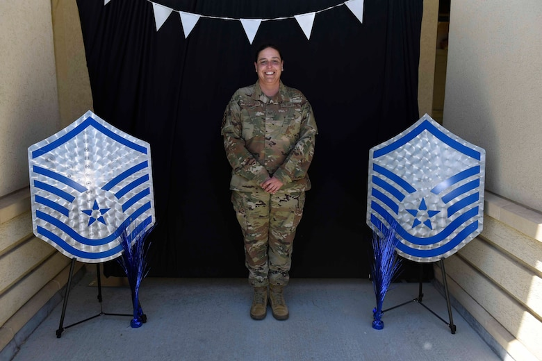 U.S. Air Force Tech. Sgt. Kari Pohlschneider, 60th Operations Support Squadron superintendent of wing intelligence, stands in a photo booth during a master sergeant release celebration July 23, 2020, at Travis Air Force Base, California. The event coordinators created a photo booth for master sergeant selects and their families to take photos. (U.S. Air Force photo by Airman 1st Class Cameron Otte)