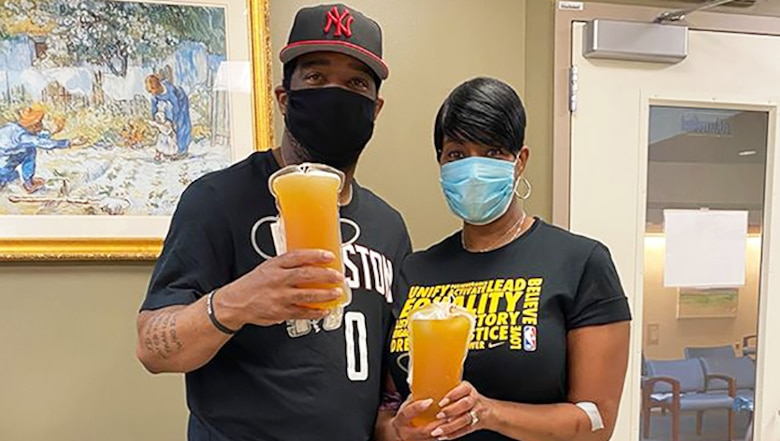 Image of retired Air Force Chief Master Sgt. Trae King-Latimer and her husband Jerome Latimer.